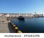 Sochi sea port, yachts at the pier, people walk along the promenade - stock photo