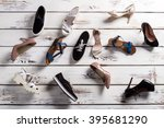 different shoes laying on floor....   Shutterstock . vector #395681290