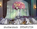 table setting at a luxury... | Shutterstock . vector #395691724