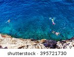 people swimming with snorkel at ... | Shutterstock . vector #395721730