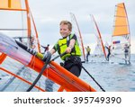 Teen Boy Raises Windsurfing...