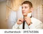 groom waiting for a meeting... | Shutterstock . vector #395765386