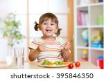 happy child girl eating... | Shutterstock . vector #395846350