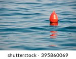 Red Buoy On The Blue Sea. A...