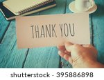 man hand holding card with the... | Shutterstock . vector #395886898