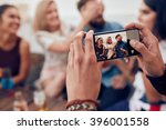 Photographing A Group Of...