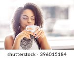 pleasant girl drinking coffee | Shutterstock . vector #396015184