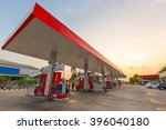 gas station at sunset. | Shutterstock . vector #396040180