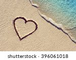 Heart Handwritten On A Sand Of...