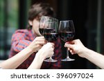 friends clink glasses of red... | Shutterstock . vector #396097024