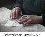 Small photo of Senior woman with little euro money, toned image, colorized, selective focus, very shallow DOF