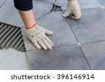 laying ceramic tiles. worker... | Shutterstock . vector #396146914