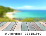 wood table top with blurred... | Shutterstock . vector #396181960