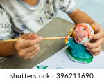 The Boy Painting Watercolor On...