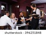 friendly young waitress serving ... | Shutterstock . vector #396251848