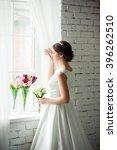 beautiful bride with bouquet... | Shutterstock . vector #396262510