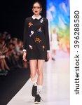 a model walks the runway on the ... | Shutterstock . vector #396288580