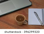 at the table with a cup of... | Shutterstock . vector #396299320
