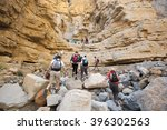 Small photo of RAS AL KHAIMAH, UNITED ARAB EMIRATES - CIRCA MARCH 2014:group of hikers walking in the mountains near Dubai