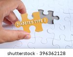 Small photo of Health conceptual, hand holding puzzle written DIABETES TYPE 2