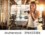 young sporty woman lifting... | Shutterstock . vector #396425386