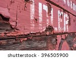 "Detail view of a freight railway car with the word ""IDLER"" and peeling red paint - stock photo"