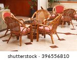 Wicker Chairs And A Round Tabl...