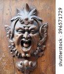 Door Knocker On An Old Wooden...