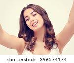 selfie.girl holding camera with ... | Shutterstock . vector #396574174