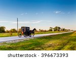 Horse And Buggy On Highway In...