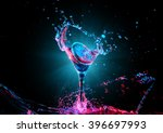 Stock photo colorful cocktail in glass with splashes and lemon on dark background party club entertainment 396697993