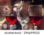 white wine pouring into wine... | Shutterstock . vector #396699010