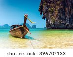 boat next to a big rock in the... | Shutterstock . vector #396702133