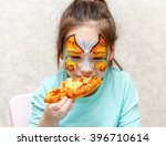 little girl with colored face...