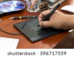 artist drawing on graphic...   Shutterstock . vector #396717559