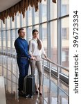 couple at airport waiting... | Shutterstock . vector #396723334