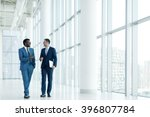 smiling businessmen in office | Shutterstock . vector #396807784