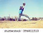 Boy Catching A Baseball ...