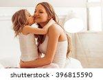 sweet little girl is hugging... | Shutterstock . vector #396815590