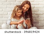 beautiful young mother and her...   Shutterstock . vector #396819424