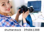 female photographer sitting on... | Shutterstock . vector #396861388