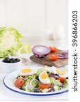 salad with tuna  black olives... | Shutterstock . vector #396866203