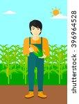 farmer holding corn. | Shutterstock .eps vector #396964528