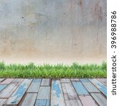 grunge wall and green grass on... | Shutterstock . vector #396988786