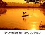 silhouette fishermen fishing in ... | Shutterstock . vector #397024480