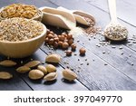 nuts and cereal seeds on black... | Shutterstock . vector #397049770