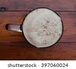 the mug of beer with foam. view ... | Shutterstock . vector #397060024