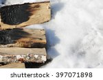Armful Of Firewood On Snow
