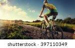 cyclist riding a bike on an off ... | Shutterstock . vector #397110349