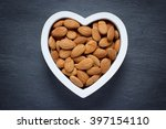 heart filled with almonds | Shutterstock . vector #397154110